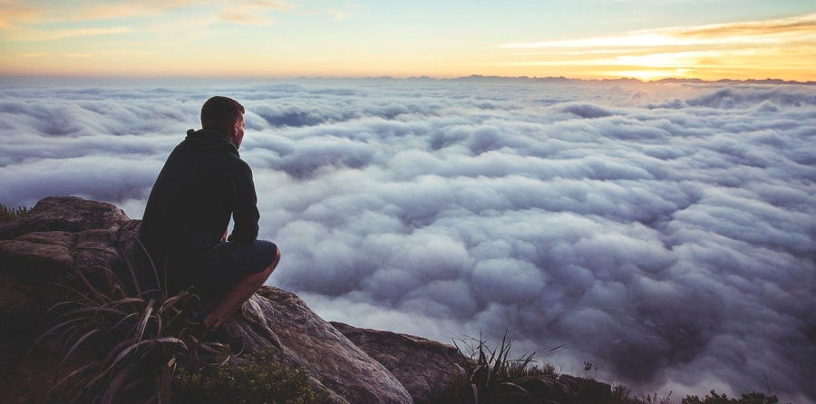 Guy sitting above the clouds